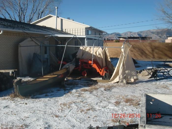 Portable Anchor On A Concrete Garage : Shelterlogic autoshelter portable garage with tan