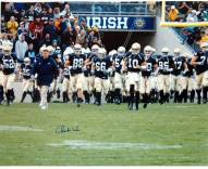 Charlie Weis Walking with Team on the Field 8 x 10 Photo