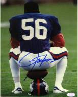 Lawrence Taylor Sitting on Football and Helmet Vertical 8 x 10 Photo