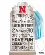 Nebraska Cornhuskers In This House Mask Holder