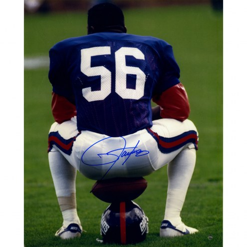"New York Giants Lawrence Taylor Sitting on Football and Helmet Signed 16"" x 20"" Photo"