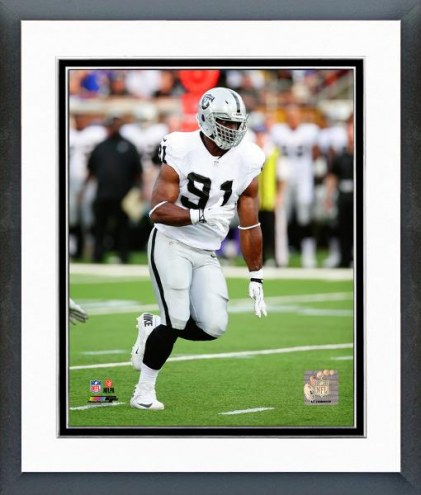 Oakland Raiders Justin Tuck 2014 Action Framed Photo